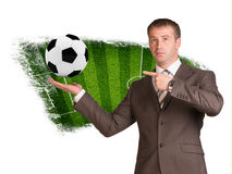 Business man hold soccer ball  in hand Stock Photo