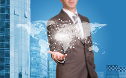 Business man hold world map and wire-frame sphere Stock Images