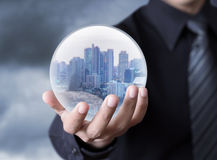 Business Man Holding A City Inside A Sphere Stock Photography
