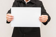 Business man holding a4 paper. For blank Stock Photo
