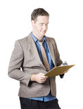 Business man holding audit clip board Stock Image