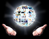 Business man holding a ball of people Stock Photography