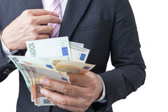 Business man holding bank notes. Royalty Free Stock Photos