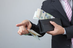 Business man holding bank notes out wallet. Stock Image