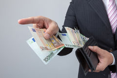 Business man holding bank notes out wallet. Stock Photos