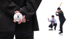 Business man holding baseball