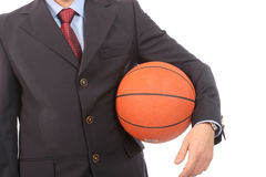 Business man holding basketball ball. Isolated on white background stock images