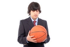 Business man holding basketball ball. Isolated on white background royalty free stock images