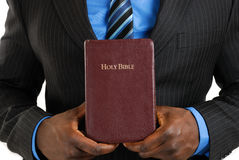 Business man holding a bible stock images