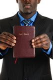 Business man holding a bible Stock Photos