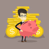 Business man holding big piggy bank. Royalty Free Stock Photos