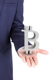 Business man holding bitcoin currency symbol stock photo
