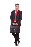 Business man holding a black leather briefcase Royalty Free Stock Photography