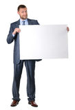 Business man holding a blank banner isolated. On white background Stock Images