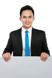 Business man holding a blank billboard Royalty Free Stock Photo