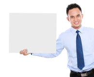Business man holding a blank billboard Royalty Free Stock Photos