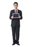 Business man holding blank blackboard Royalty Free Stock Photo