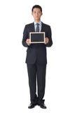 Business man holding blank blackboard Royalty Free Stock Photo