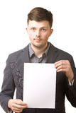 Business man holding a blank board. Portrait of a young business man holding a blank board Stock Images