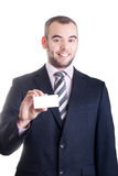 Business man holding a blank business card Stock Images
