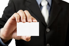 Business man holding blank business card royalty free stock images