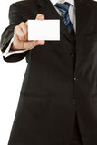 Business man holding blank business card isolated on white Stock Image