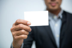 Business man holding blank business card on white background.  Stock Photo