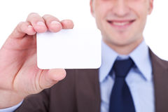 Business man holding a blank card Royalty Free Stock Images