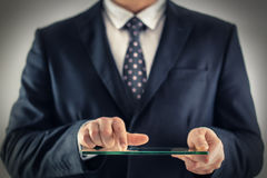 Business man holding blank futuristic transparent mobile, smart Stock Photos