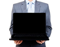Business man holding blank laptop Royalty Free Stock Photography