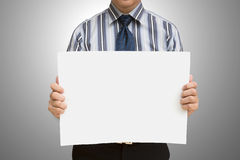 A business man holding blank paper Stock Photography