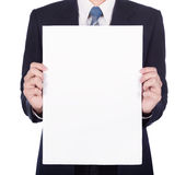 Business man holding a blank paper sheet isolated on white Royalty Free Stock Images