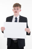 Business man holding blank paper on white background Stock Photo