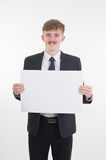 Business man holding blank paper on white background Royalty Free Stock Images