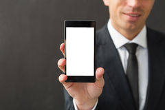 Business man holding blank screen smartphone Royalty Free Stock Photography