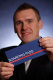 Business man holding a boarding pass Stock Photography