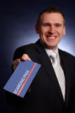 Business man holding a boarding pass Stock Photo