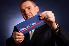 Business man holding a boarding pass Royalty Free Stock Photo