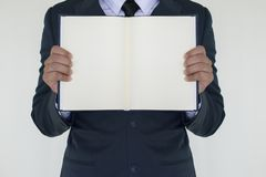 Business man holding the book. On white background Stock Photo