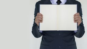Business man holding the book. On white background Royalty Free Stock Photo
