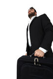 Business man holding brief case and walking Royalty Free Stock Images