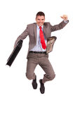Business man holding briefcase and jumping Royalty Free Stock Image