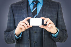 Business man holding business card with room for text and graphic. Great for ads, publications and presentations Royalty Free Stock Photo