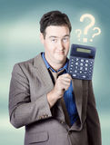 Business man holding calculator. Money question Stock Photo