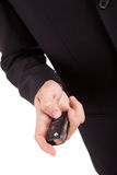 Business man holding car key Stock Photography