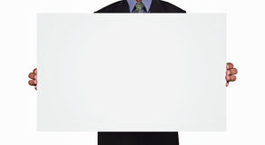 Business man holding card in black suit isolated on white backgr Royalty Free Stock Images
