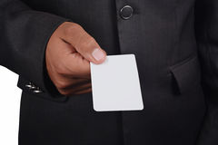 Business man holding card in black suit isolated on white backgr. Ound Royalty Free Stock Image