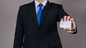 Business man holding card on isolated Stock Photography