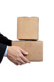 Business man holding cardboard moving box on white. Business man holding a brown corrugated, cardboard moving box on white with copy space Royalty Free Stock Images