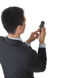 Business man holding cellphone Royalty Free Stock Images